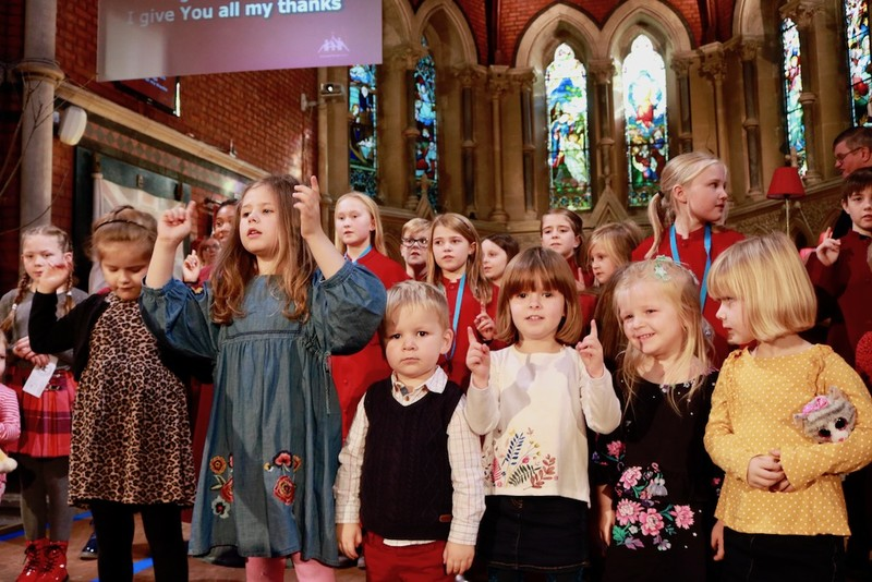 The children lead their song