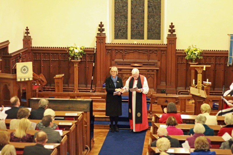 Bishop Harold presents June to the congregation