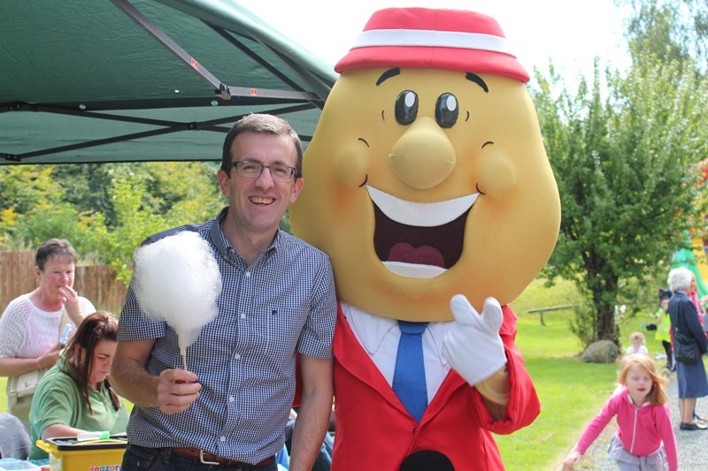 Andrew Brannigan with Mr Tayto