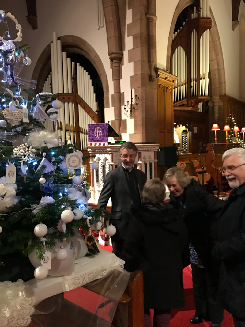 Bishop Harold viewing the display of Christmas trees